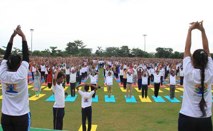 KIIT & KISS staff practise yoga to mark the International Day of Yoga observed in KIIT University.