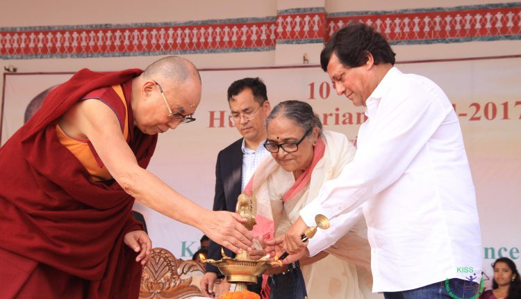 His Holiness The Dalai Lama lighting the traditional lamp at the ceremony.