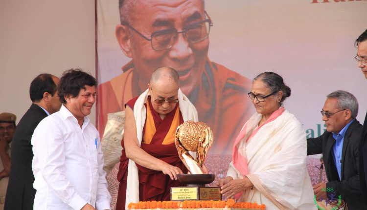 His Holiness The Dalai Lama receiving the KISS Humanitarian Award in the presence of esteemed dignitaries